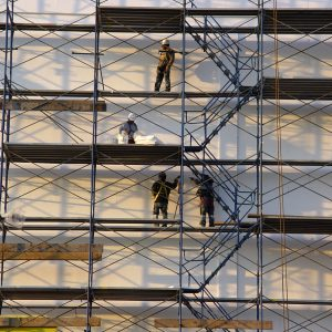 Photo of Construction Workers on Scaffolding.