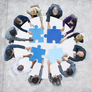Business People and Jigsaw Puzzle Pieces