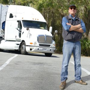 Truck driver with arms crossed